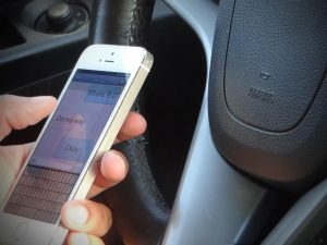 Texting-Driving-Female-300x225